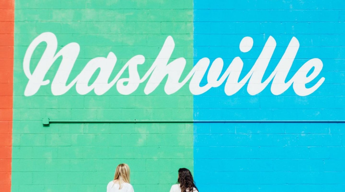 Image of two girls standing in front of a mural in Nashville Tennessee