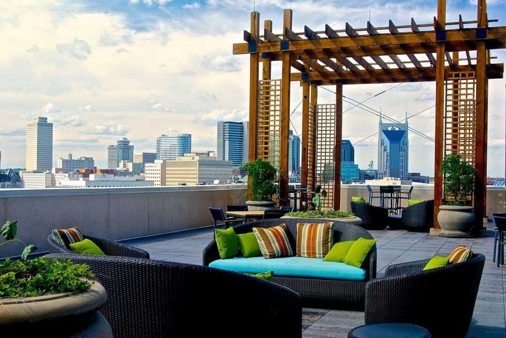 Image of a condo rooftop with a view of downtown Nashville in the background