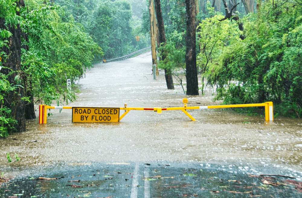 Image of a road that is closed due to a flood