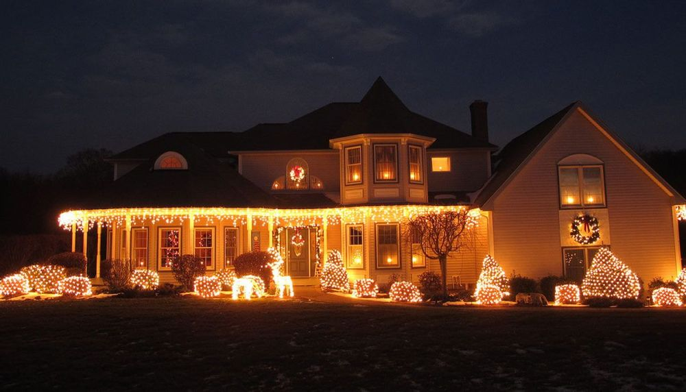 Image depicting a house decorated with Christmas lights