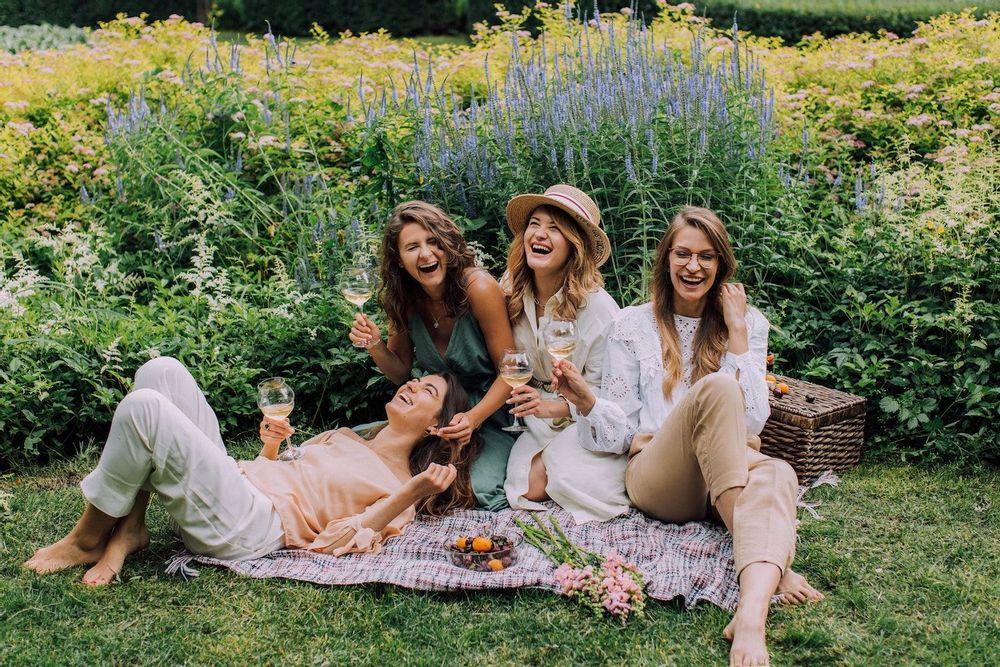 Image of four women having a picnic in a garden