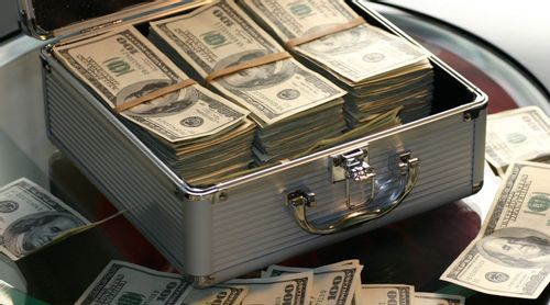 An image of a briefcase with stacks of hundred dollar bills inside