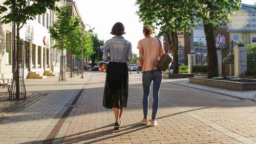 Image of two women walking in a city