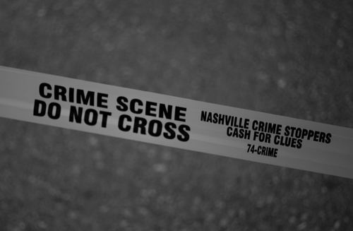 """Image with police crime tape that says """"Crime Scene Do Not Cross"""""""