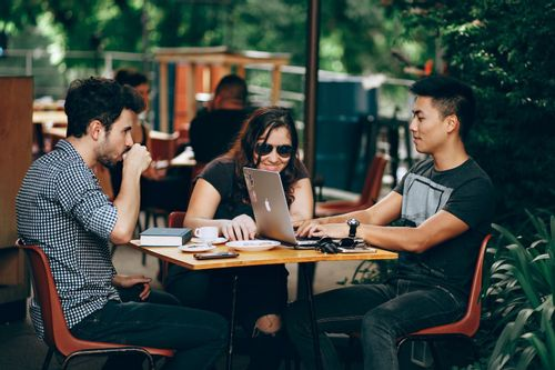 Image of three millennials sitting at a table