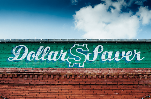 Mural painted on a brick building with the words 'Dollar Saver'